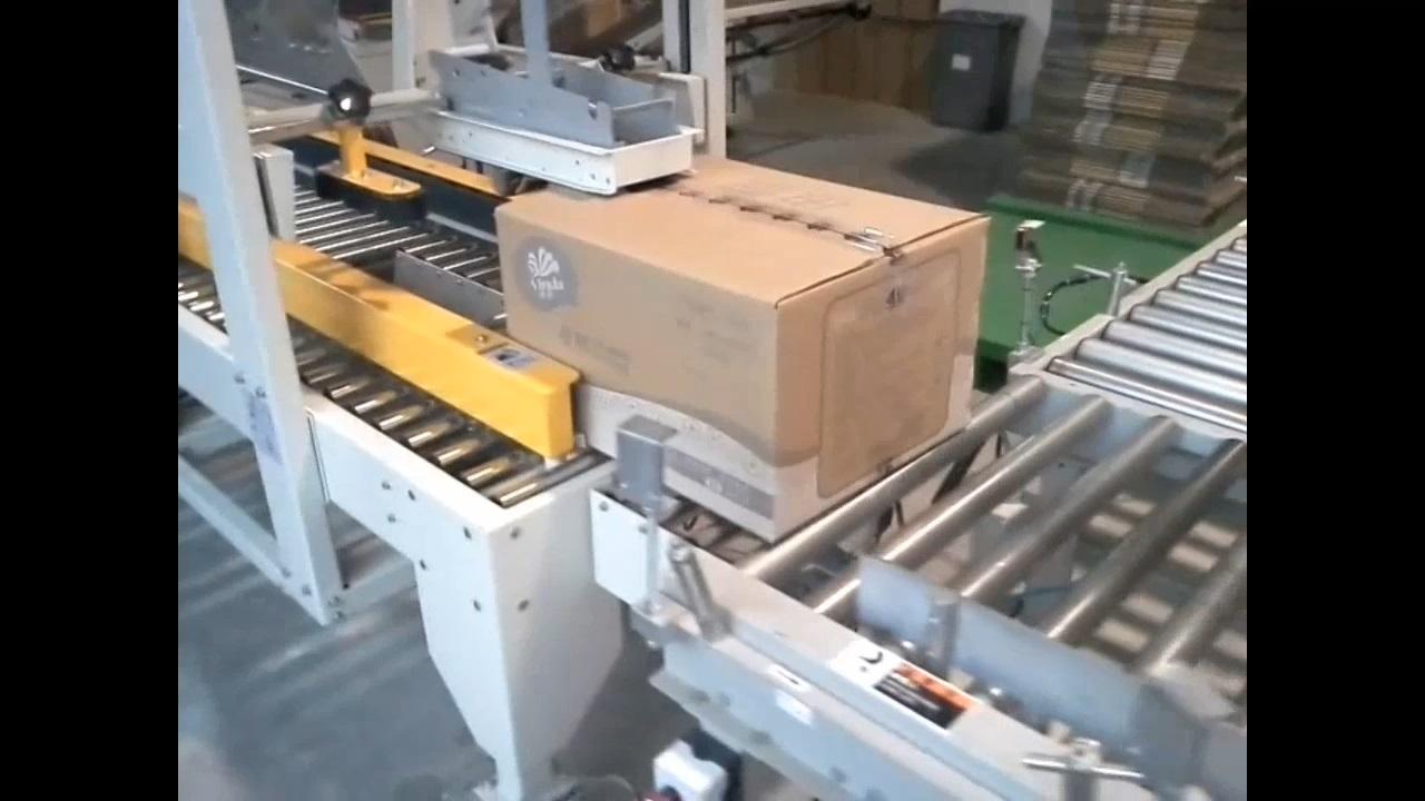 纸巾厂自动开箱折盖封箱机案例视